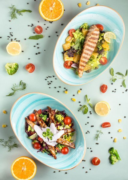 Fresh dishes with grilled salmon