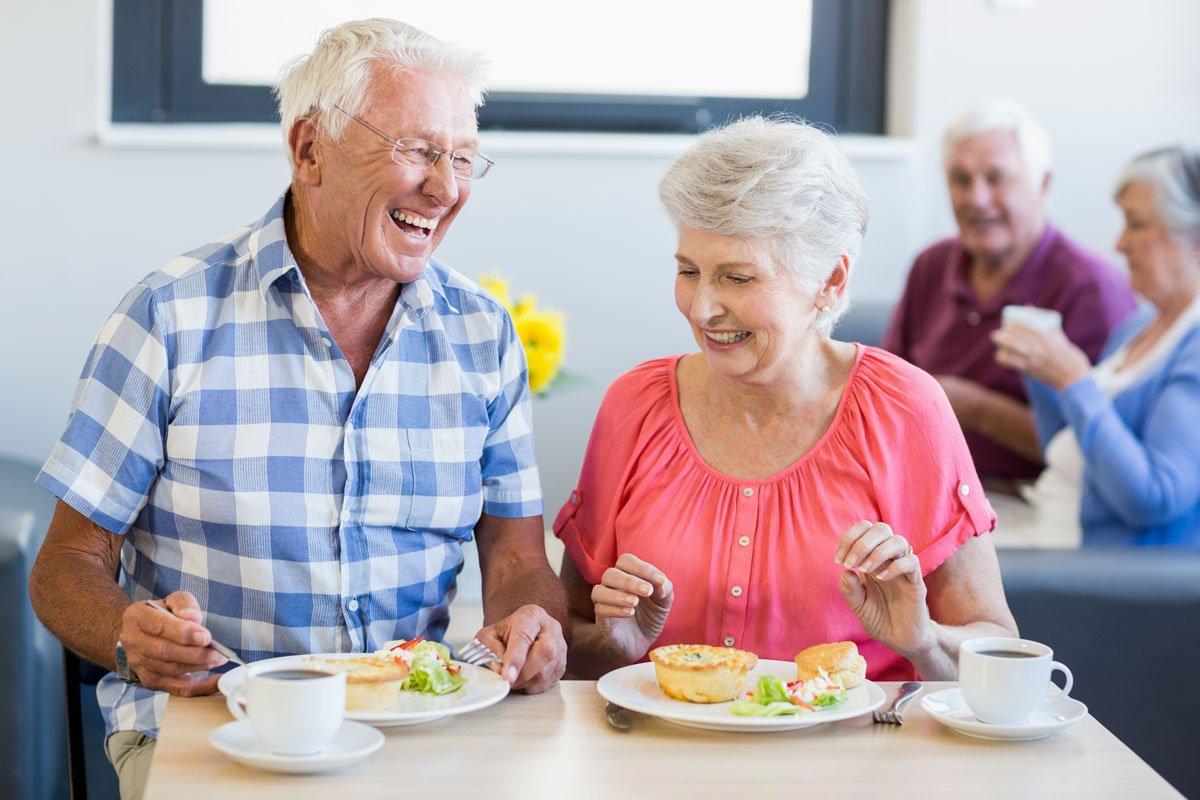 Senior citizens eating together